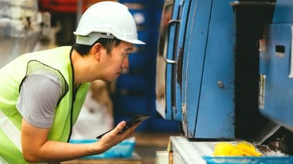 engineer performs factory acceptance test with mobile device